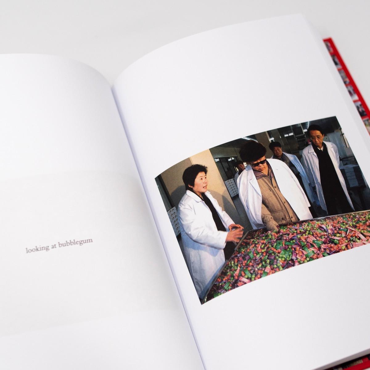 Photo of Kim Jong Il Looking at Things